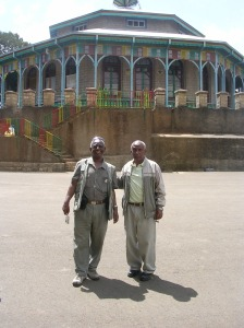 Tesfagiorgis Wondimagegnehu and Tesfamichael Tekle in front of Entoto Maryam Church on Entoto Mountain