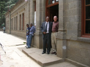 Berhane and Doug at the entrance to the former Tafari Makonnen School administration building