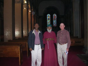 :  Berhane, Priest, and Doug at Kiddist Selassie Cathedral, where Emperor Haile Selassie and Empress Menen are buried