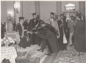 Moges receiving his MD degree from Emperor Haile Selassie in 1972; Dr. Aklilu Habte standing next to HIM